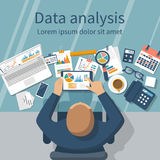 Data analysis concept. Tablet in hands businessman, statistical data with charts, diagrams. Workplace documents for financial analysis, statistics, reporting Royalty Free Stock Photography