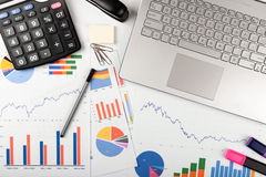 Data analysis - workplace with business graphs and charts Stock Images