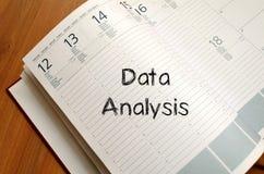 Data analysis write on notebook Stock Photography