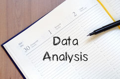 Data analysis write on notebook Royalty Free Stock Photography