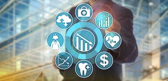 Data Analyst Monitoring Health Care Cost Reduction. Unrecognizable data manager operating an analytics application designed to monitor healthcare cost reduction Stock Images