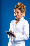Data analysys by scientist or researcher. Young woman on a white coat using a digital tablet, concept of research or science Royalty Free Stock Photo
