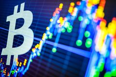 Data analyzing in exchange stock market: the candle chars on dis. Play. Analytics price change cryptocurrency BTC to USD & x28;Bitcoin / US Dollar& x29;, the Stock Photo