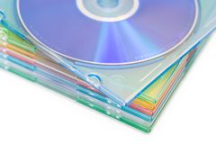 Data backup. Media: boxes of pastel coloured CDs or DVDs. Shallow depth of field with a slight high-key effect stock images