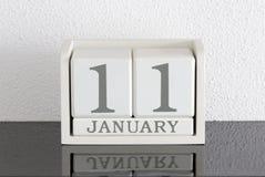 Data bianca 11 del presente del calendario di blocco e mese gennaio Fotografia Stock