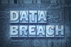 Data breach pc board. Data breach made from metallic letterpress blocks on the pc board background Royalty Free Stock Photography