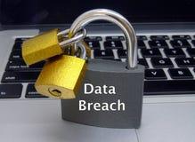 Data Breach Padlocks on Laptop Keyboard. Closeup of padlocks with words `Data Breach` on laptop keyboard Stock Image