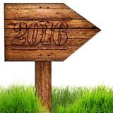 Data 2016 burned on wooden arrow sign against on white background. Royalty Free Stock Image