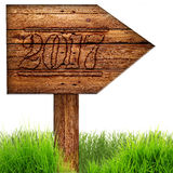 Data 2017 burned on wooden sign against a white background. Royalty Free Stock Photos