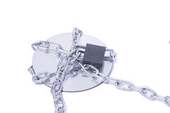 Data on CD-ROM secured with chain Stock Photo