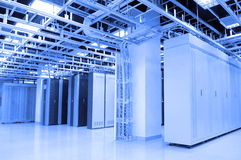 Data center. A shot of network cables and servers in a technology data center royalty free stock images