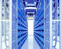 Data center. A shot of network cables and servers in a technology data center