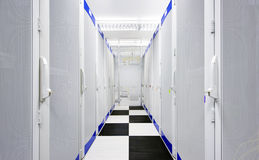 Data Center. Clean suite in a data center with the perforated doors of server racks royalty free stock photos