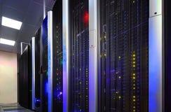 Data center full of server cabinets and racks Stock Image