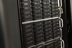 Data center with hard drives. Server rack cluster in a data center Royalty Free Stock Images