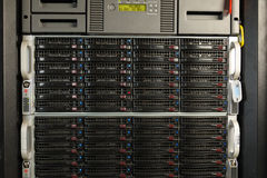 Data center with hard drives. Server rack cluster in a data center Royalty Free Stock Photography