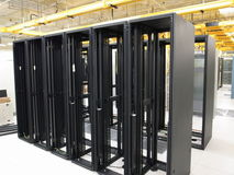 Data Center rack and stacks. A typical setup of Data center. Communication racks in a datacenter filled with switches and routers that keep all the servers Stock Photography