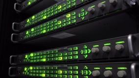 Data center server racks blinking LED green lights. Audio telecommunication racks