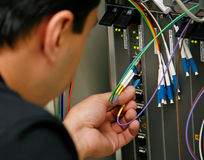 Data Center Technician. With colored cables royalty free stock images