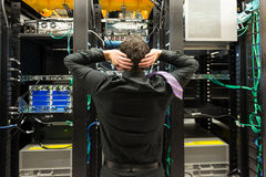 Data center trouble. Man wearing a tie looking astonished in a network data center stock images