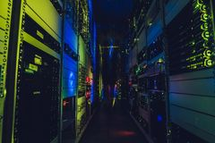 Data centre interface. Blurred woman is walking in data centre. IT engineer specialist in network server room. Running diagnostics and maintenance. Technician Stock Photo