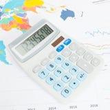 Data charts with calculator conceptual series - close up studio shot Stock Image