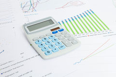 Data charts with calculator on the table series Stock Images