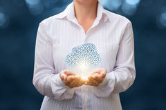 Data cloud in the hands of a businesswoman. Stock Photos