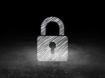 Data concept: Closed Padlock in grunge dark room Royalty Free Stock Images