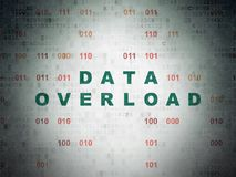 Data concept: Data Overload on Digital Data Paper background. Data concept: Painted green text Data Overload on Digital Data Paper background with Binary Code Stock Photo