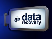 Data concept: Data Recovery and Gears on billboard background. Data concept: Data Recovery and Gears on advertising billboard background, 3D rendering Stock Photos