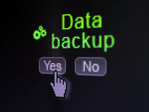 Data concept: Gears icon and Data Backup on digital computer screen Royalty Free Stock Image