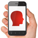 Data concept: Head on smartphone. Data concept: hand holding smartphone with Head on display. Mobile smart phone on White background, 3d render Stock Photo