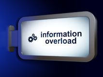 Data concept: Information Overload and Gears on billboard background. Data concept: Information Overload and Gears on advertising billboard background, 3D Royalty Free Stock Images