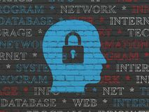 Data concept: Head With Padlock on wall background. Data concept: Painted blue Head With Padlock icon on Black Brick wall background with  Tag Cloud Royalty Free Stock Photo