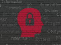 Data concept: Head With Padlock on wall background. Data concept: Painted red Head With Padlock icon on Black Brick wall background with  Tag Cloud Stock Photo