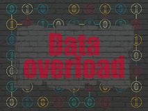 Data concept: Data Overload on wall background. Data concept: Painted red text Data Overload on Black Brick wall background with Scheme Of Binary Code Stock Photo