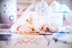 Data concept. Young woman doing paperwork at office desktop with digital business display. Close up. Toned image. Data concept. Double exposure Royalty Free Stock Photo