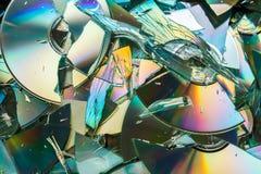 Data destruction: broken CD and DVD disks Stock Image