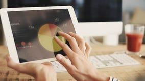 Data on digital tablet stock footage