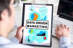 Data driven marketing concept on a clipboard. Man holding a clipboard with data driven marketing concept royalty free stock image
