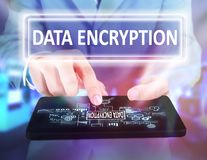 Data Encryption in Business Concept. Business Concept. Businessman click data encryption button on his tablet. Modern Text typography design stock photo