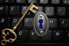 Data encryption key lock. Lock and key on computer keyboard with digital keyhole -- data encryption concept royalty free stock photos