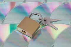 Data encryption and security (CD with lock). Data encryption and security visualized by bunch of CDs with lock and keys Stock Images