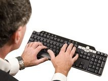 Data Entry. Photo of a man performing data entry royalty free stock photo