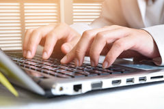 Data entry. Women key information into the computer stock photos