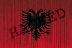 Data Hacked Albania flag. Albania flag with binary code. Royalty Free Stock Images