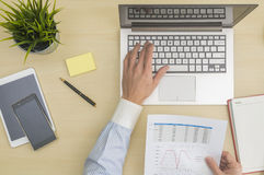 Data input and analysis at office Stock Photography