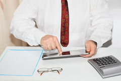 Data input. On a mobile computer in office Royalty Free Stock Photos