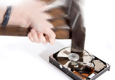 Data loss. Hammer in full motion damaging an opened hard drive Stock Photo